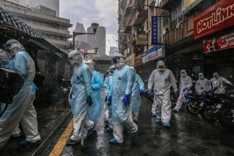 Health workers in protective suits are seen at Selangor Mansion in Jalan Masjid India April 6, 2020. —Picture by Firdaus Latif