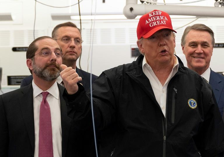 Representative Doug Collins (2L) joined President Donald Trump to tour the Centers for Disease Control and Prevention on March 6 -- he has since been told he was exposed to the new coronavirus before the visit