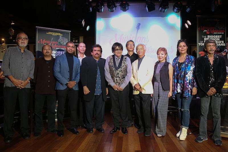 A small collection of musicians that will be playing on March 5, 2020 gather onstage to announce the Benefit concert.