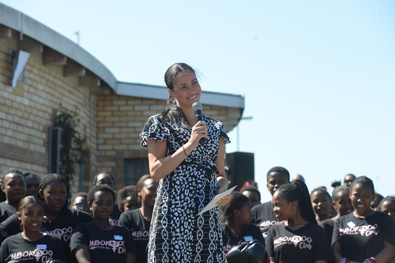 """Meghan, Duchess of Sussex delivers a speech during a visit with the Duke of Sussex to the """"Justice desk"""", an NGO in the township of Nyanga in Cape Town, as they begin their tour of the region on September 23, 2019. - Britain's Prince Harry and his wife Meghan arrived in South Africa on September 23, launching their first official family visit in the coastal city of Cape Town. The 10-day trip began with an education workshop in Nyanga, a township crippled by gang violence and crime that sits on the outskirts of the city. (Photo by Courtney AFRICA / POOL / AFP) (Photo credit should read COURTNEY AFRICA/AFP via Getty Images)"""