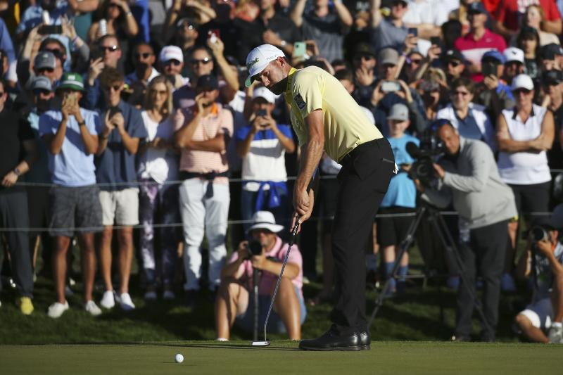 Webb Simpson watches his winning putt on 18th green on the first playoff hole during the final round of the Waste Management Phoenix Open PGA Tour golf event Sunday, Feb. 2, 2020, in Scottsdale, Ariz. (AP Photo/Ross D. Franklin)