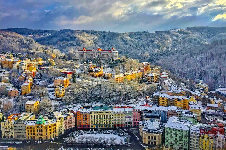 <p>While the Eastern European city of Zubrowka is fictional, production designer Adam Stockhausen and director Wes Anderson spent time across the Czech Republic pulling inspiration from various multicolored towns including the famous spa town of Karlovy Vary. Visitors to this Czech city will find a strikingly similar hotel, The Hotel Imperial, sitting atop a mountain overlooking the city.</p>