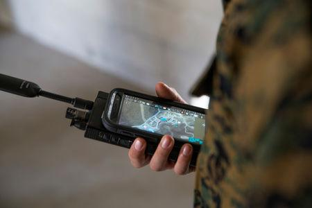 FILE PHOTO: A U.S. Marine is assessed utilizing a communications radio with real time on screen GPS location during Urban Advanced Naval Technology Exercises 2018 (ANTX18) at Camp Pendleton, California, U.S. March 20, 2018. Picture taken March 20, 2018.  U.S. Marine Corps/Lance Cpl. Cutler Brice/Handout via REUTERS./File Photo