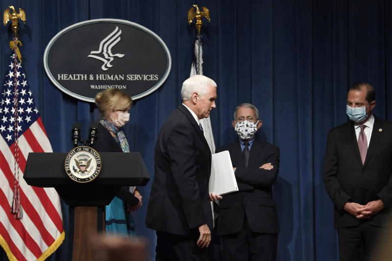 Vice President Mike Pence, second from left, walks off of the stage following the conclusion of a briefing with the Coronavirus Task Force at the Department of Health and Human Services in Washington, Friday, June 26, 2020. Dr. Deborah Birx, left, Dr. Anthony Fauci, second from right, and Health and Human Services Secretary Alex Azar, right, follow Pence. (AP Photo/Susan Walsh)