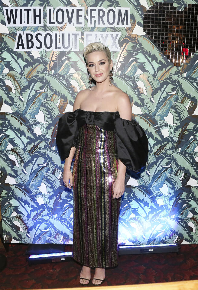 <p>Perry opted for an off the shoulder sequinned gown by Russian designer, Rasario, for Mark Ronson's Club Heartbreak Grammy Party.<br />(Image via Getty Images) </p>