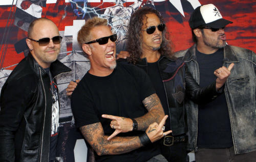"FILE - In this Saturday, July 28, 2012 file photo, members of the band Metallica, from left to right; Lars Ulrich, James Hetfield, Kirk Hammett and Robert Trujillo, pose before their first of eight concert performances in Mexico City. Metallica is set to rock the legendary Apollo Theater in Harlem venue on Sept. 21. It will promote their 3D concert-action film ""Metallica Through the Never,"" released in IMAX on Sept. 27 and other theaters a week later. It will also air live on a special temporary Metallica channel on SiriusXM. (AP Photo/Marco Ugarte, File)"