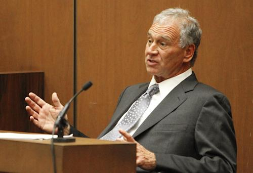"FILE - In this Sept. 28, 2011 file photo, concert promoter and producer on Michael Jackson's ill-fated ""This Is It"" tour, Paul Gongaware, testifies on the second day of Dr. Conrad Murray's involuntary manslaughter trial in the death of pop star Michael Jackson in downtown Los Angeles. A judge has dismissed two executives from a lawsuit filed by Michael Jackson's mother against the promoters of his planned comeback concerts. Superior Court Judge Yvette Palazuelos ruled Monday, Sept. 9, 2013, that lawyers for Katherine Jackson hadn't proved claims that AEG Live LLC CEO Randy Phillips and promoter Paul Gongaware were liable for her son's death. (AP Photo/Al Seib, Pool, File)"