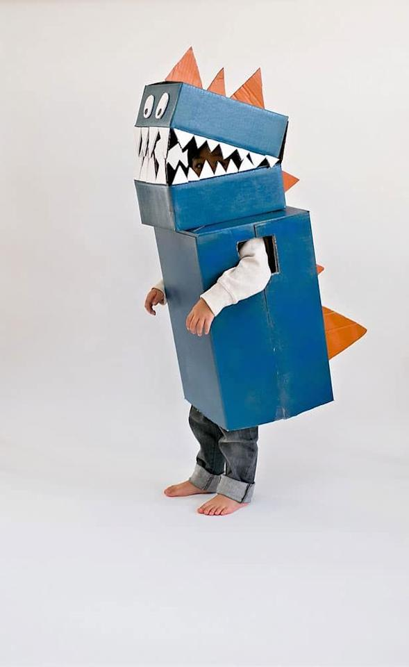 """<p>Put all your delivery boxes to good use, and upcycle them into a dinosaur costume. It'll make kids feel like towering T-Rexes.</p><p><em><a href=""""https://www.hellowonderful.co/post/diy-cardboard-dinosaur-costume/"""" target=""""_blank"""">Get the tutorial at Hello, Wonderful »</a></em></p>"""