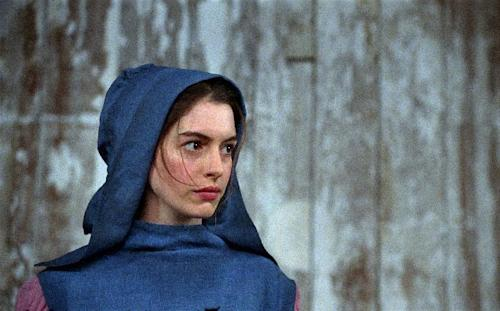 "This film image released by Universal Pictures shows Anne Hathaway as Fantine in a scene from ""Les Miserables."" (AP Photo/Universal Pictures)"