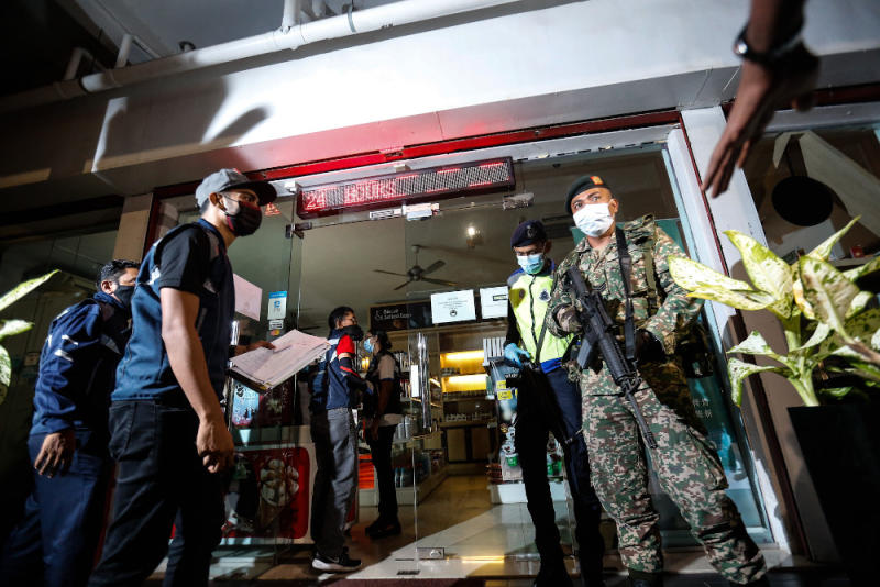 Penang Island City Council officers, together with police and army personnel conducted an operation to check on all business premises around George Town last night. — Picture by Sayuti Zainudin