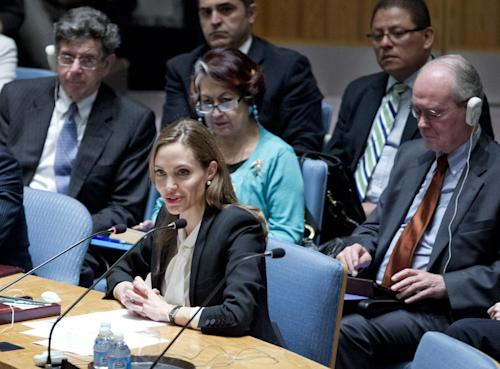 "In this photo provided by the United Nations, actress Angelina Jolie makes her debut before the Security Council at the U.N. headquarters as a special envoy for refugees to urge the world's nations to make the fight against rape in war a top priority, Monday June 24, 2013. Jolie, a goodwill ambassador for the U.N. high commissioner for refugees, said the Security Council has witnessed 67 years of wars and conflict since it was established ""but the world has yet to take up warzone rape as a serious priority."" (AP Photo/United Nations, Rick Bajornas)"