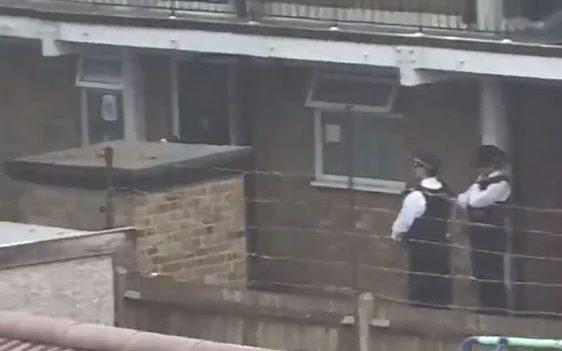 Police outside a property in Goodmayes in Redbridge - PA