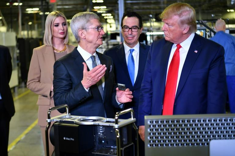 US Treasury Secretary Steven Mnuchin, seen with President Donald Trump (R) and Apple CEO Tim Cook (2nd L), said countries should suspend unilateral taxes on tech giants