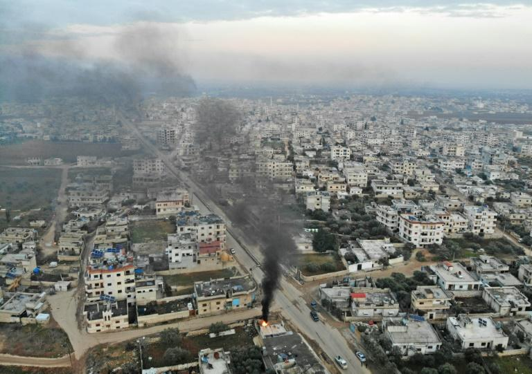Smoke billows from tyres burnt by Syrians in an attempt to hinder air strikes in the town of Binnish in Idlib province