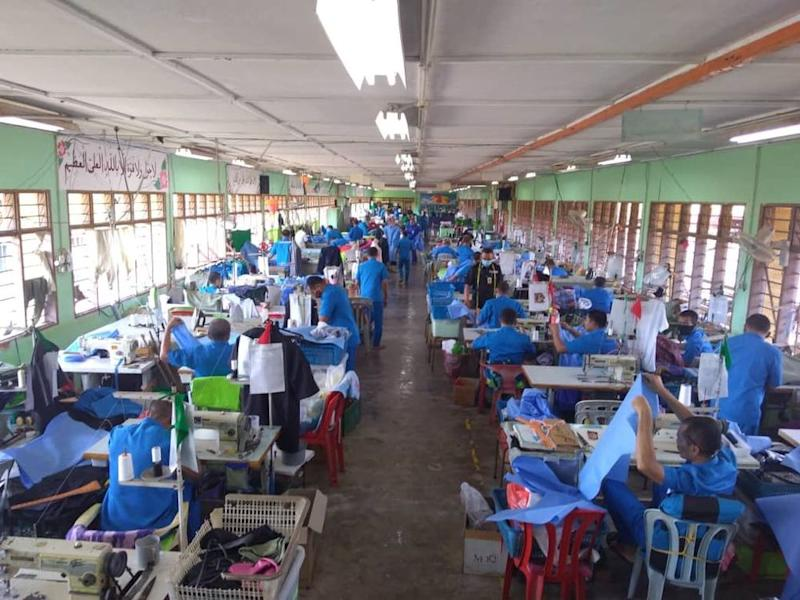 The inmates are tasked to measure, cut and sew the protective gear required by health workers treating Covid-19 patients. — Picture courtesy of Twitter/Malaysian Prisons Department