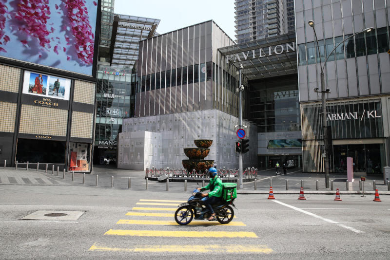 A food delivery rider rides past Pavilion in Kuala Lumpur March 21, 2020. — Picture by Yusof Mat Isa