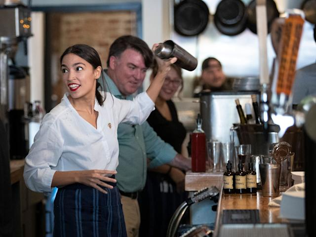 NEW YORK, NY - MAY 31: U.S. Rep. Alexandria Ocasio-Cortez (D-NY) shakes a margarita behind the bar at the Queensboro Restaurant, May 31, 2019 in the Queens borough of New York City. Ocasio-Cortez participated in an event to raise awareness for the One Fair Wage campaign, which calls to raise the minimum wage for tipped workers to a full minimum wage at the federal level. (Photo by Drew Angerer/Getty Images)
