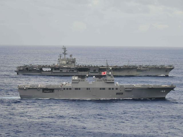 The USS Ronald Reagan sails alongside Japan's Hyuga-class helicopter destroyer Ise: Reuters