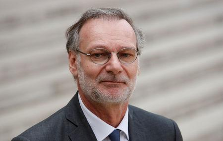 """Accenture CEO Pierre Nanterme leaves after the """"Tech for Good"""" Summit at the Elysee Palace in Paris"""