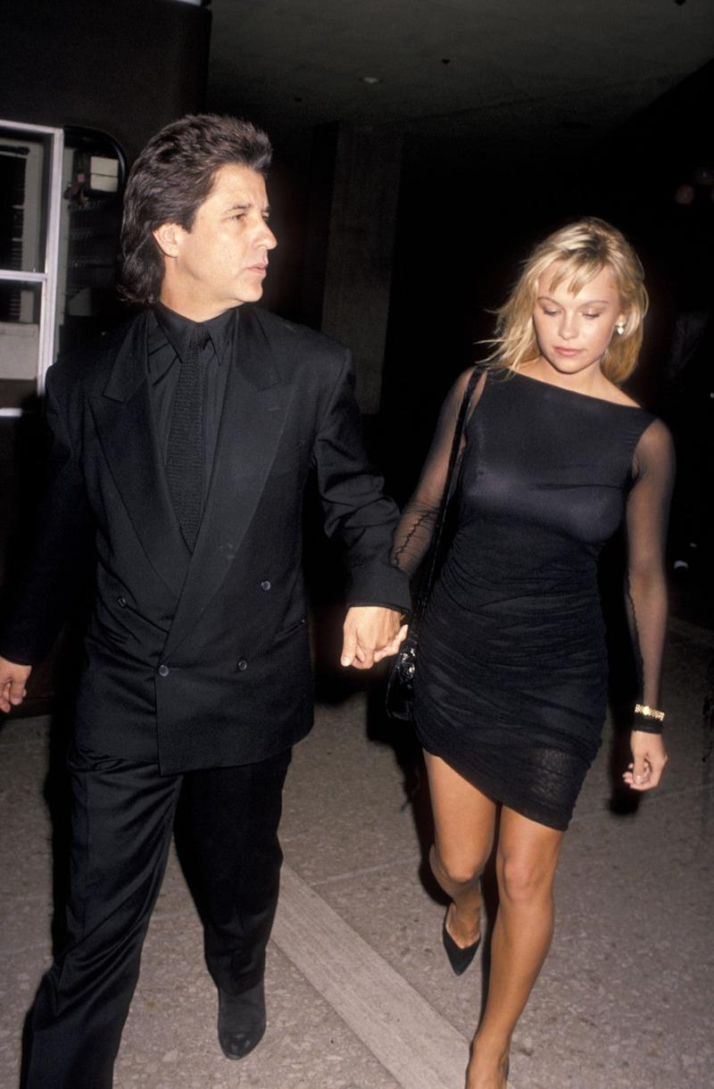 Producer Jon Peters and model Pamela Anderson attend the premiere of 'Glory' on December 11, 1989 at the Cineplex Odeon Cinema in Century City, California.