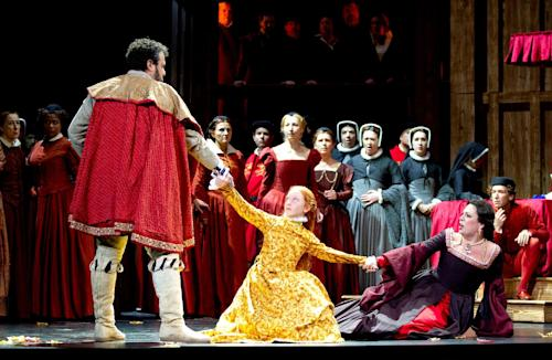 This undated handout photo provided by the Washington National Opera shows a scene from Anna Bolena: from left, Oren Gradus as Henry VIII, Josie Williams as the young Princess Elizabeth, Sondra Radvanovsky as Anne Boleyn, and Aaron Blake as Sir Hervey. (AP Photo/Scott Suchman, Washington National Opera)