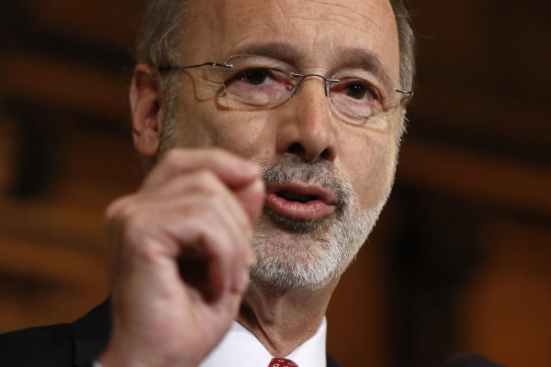 FILE - In this Dec. 29, 2015 file photo, Pennsylvania Gov. Tom Wolf speaks with members of the media at the state Capitol in Harrisburg, Pa. Many state and local governments across the country have suspended public records requirements amid the coronavirus pandemic, denying or delaying access to information that could shed light on key government decisions.   (AP Photo/Matt Rourke, File)