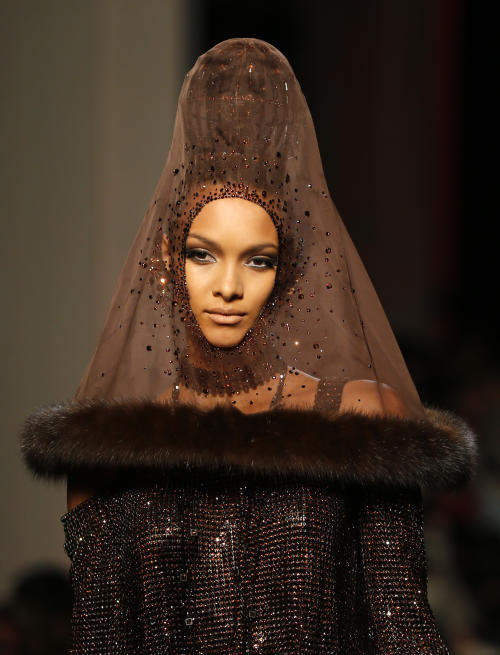 A model wears a creation for Jean-Paul Gaultier's Haute Couture Fall-Winter 2013-2014 collection presented Wednesday, July 3, 2013 in Paris. (AP Photo/Jacques Brinon)