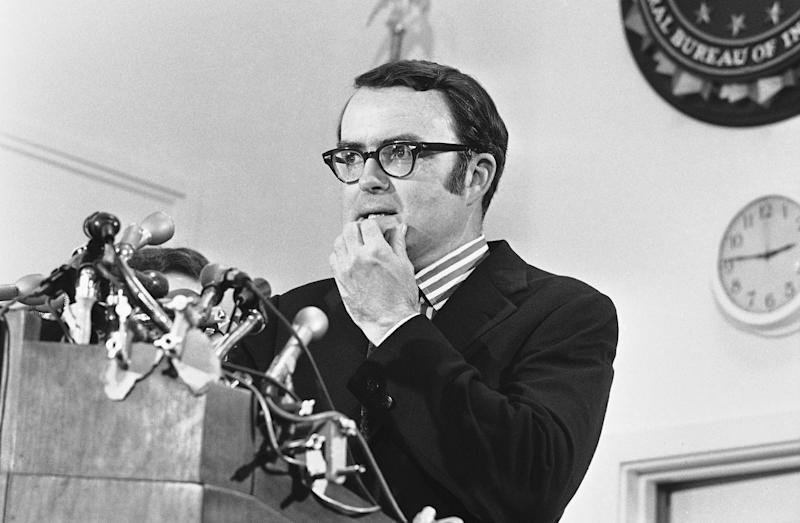FILE - In this May 15, 1973, file photo, then-acting FBI director William Doyle Ruckelshaus pauses during a news conference in Washington. Ruckelshaus, who famously quit his job in the Justice Department rather than carry out President Richard Nixon's order to fire the special prosecutor investigating the Watergate scandal, has died. He was 87. The EPA confirmed his death in a statement Wednesday, Nov. 27, 2019. (AP Photo/Charles Gorry)