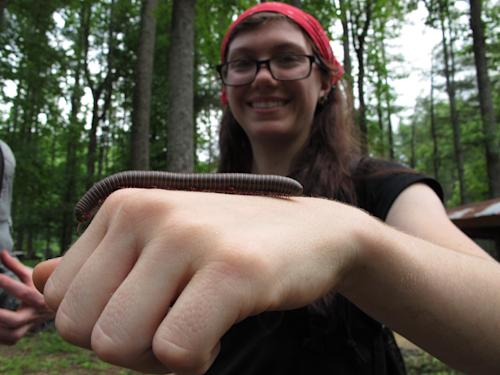 Camper Erin Krichilsky, 17, shows a millipede she found during a break at Turtle Island Preserve in Triplett, N.C., on Thursday, June 27, 2013. People like the Charlotte woman come from all over the world to learn natural living and how to go off-grid, but local officials ordered the place closed over health and safety concerns. (AP Photo/Allen Breed)