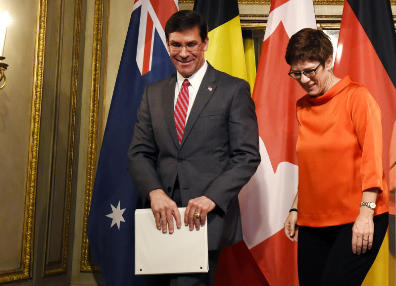 U.S. Secretary for Defense Mark Esper, left, and German defense minister Annegret Kramp-Karrenbauer leave the stage after a press conference on the first day of the Munich Security Conference in Munich, Germany, Friday, Feb. 14, 2020. (AP Photo/Jens Meyer)b