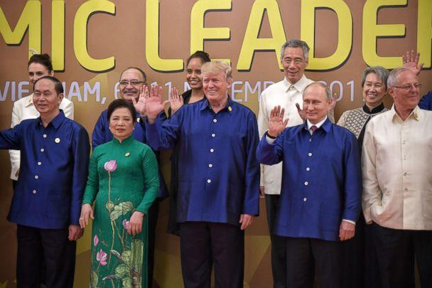 PHOTO: President Donald Trump (C), and Russian President Vladimir Putin (2-R) pose for a group photograph with fellow APEC leadersat the 25th Asia-Pacific Economic Cooperation summit (APEC) at the Sheraton Hotel in Da Nang, Vietnam, Nov. 10, 2017. (Kua Chee Siong/The Straits Times via EPA)