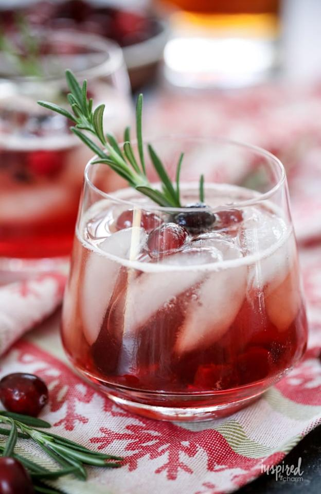 """<p>If you love a good tart-meets-sweet combination, the <a href=""""http://inspiredbycharm.com/maple-cranberry-bourbon-cocktail/"""" target=""""_blank"""" class=""""ga-track"""" data-ga-category=""""Related"""" data-ga-label=""""http://inspiredbycharm.com/maple-cranberry-bourbon-cocktail/"""" data-ga-action=""""In-Line Links"""">maple cranberry bourbon cocktail</a> is for you. The secret lies within its maple cranberries, which are extremely easy to heat over the stove. Garnish it with fresh rosemary, and you'll have the most delicious Thanksgiving drink. </p>"""