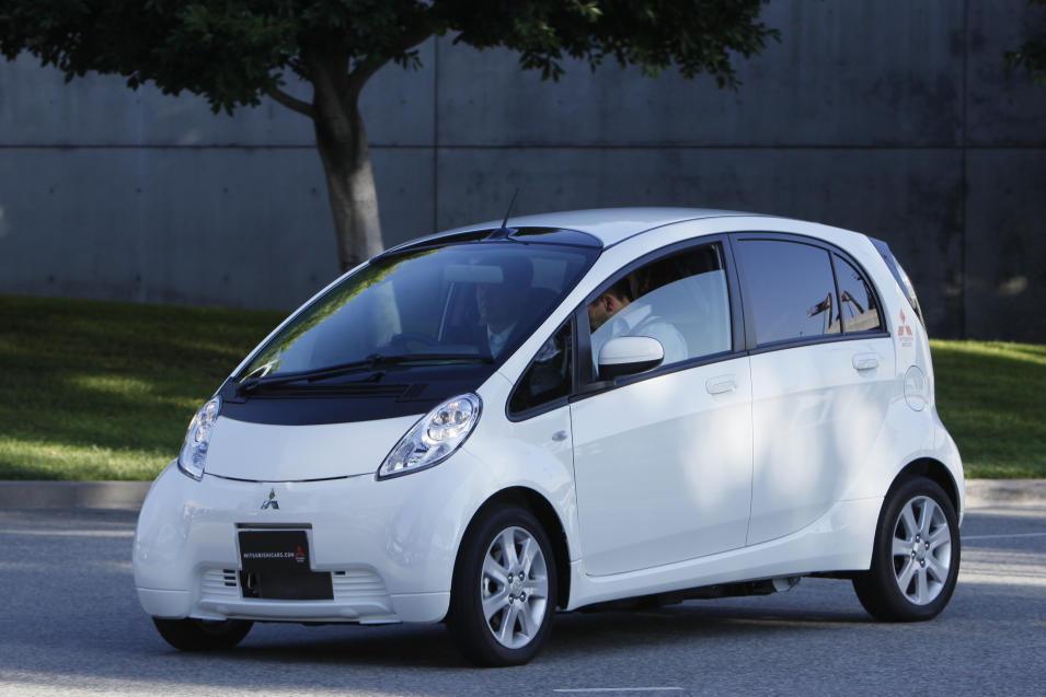 The Mitsubishi i-MiEV is test driven outside the Los Angeles Convention Center as part of the 2010 Los Angeles Auto Show Thursday, Nov. 18, 2010. (AP Photo/Damian Dovarganes)