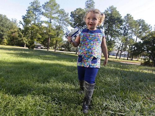 "FILE - This Sept. 10, 2012 file photo shows, seven-year-old beauty queen and reality show star Alana ""Honey Boo Boo"" Thompson at her home in McIntrye , Ga., Alana and her family are featured on the hit show ""Here Comes Honey Boo Boo"". The TLC network said Wednesday that it has ordered Halloween, Thanksgiving and Christmas specials focusing on its seven-year-old breakout star Honey Boo Boo. The series airs its 10th and final episode of its debut season on Wednesday, Sept. 26. (AP Photo/John Bazemore)"