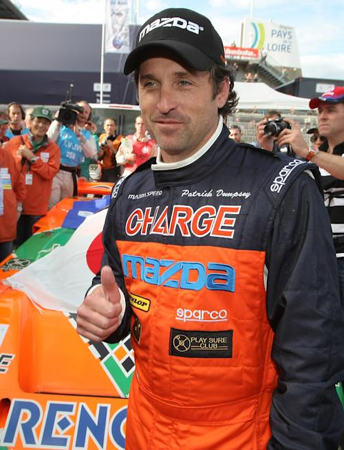"FILE - In this June 9, 2011 file photo, actor Patrick Dempsey poses for photographs in front of the Mazda 787 B, which won the race in 1991, in Le Mans, western France. Dempsey is producing and will be featured in ""Road to Le Mans,"" a Velocity channel series that will follow the actor-race car driver as he prepares for the famed auto endurance race. (AP Photo/Vincent Michel, file)"