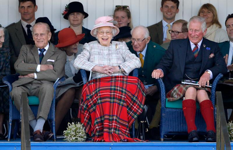 BRAEMAR, UNITED KINGDOM - SEPTEMBER 02: (EMBARGOED FOR PUBLICATION IN UK NEWSPAPERS UNTIL 48 HOURS AFTER CREATE DATE AND TIME) Prince Philip, Duke of Edinburgh, Queen Elizabeth II and Prince Charles, Prince of Wales attend the 2017 Braemar Gathering at The Princess Royal and Duke of Fife Memorial Park on September 2, 2017 in Braemar, Scotland. (Photo by Max Mumby/Indigo/Getty Images)