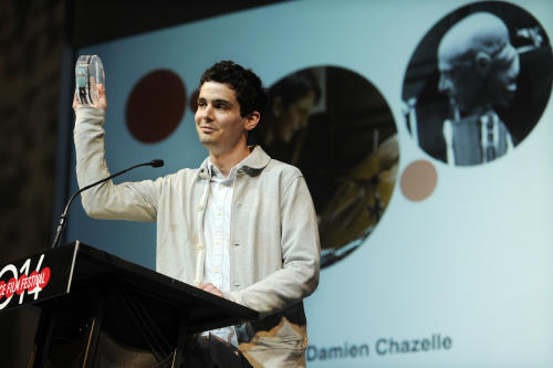 "Damien Chazelle, director of ""Whiplash,"" accepts the Grand Jury Prize: Dramatic award for his film during the 2014 Sundance Film Festival Awards Ceremony on Saturday, Jan. 25, 2014, in Park City, Utah. (Photo by Chris Pizzello/Invision/AP)"