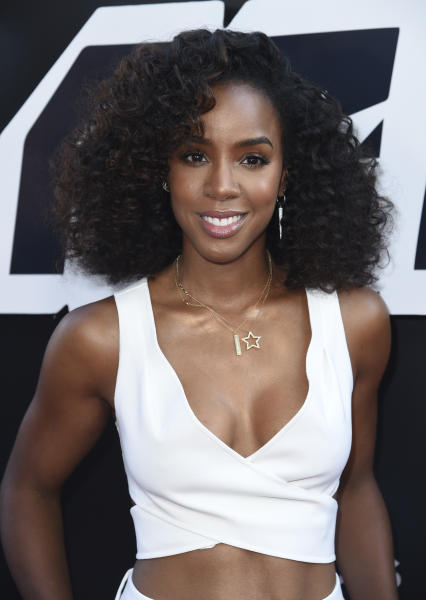 """FILE - This Aug. 8, 2018 file photo shows Kelly Rowland at the premiere of """"BlacKkKlansman"""" in Beverly Hills, Calif. Rowland says her new single """"Coffee"""" and its accompanying music video is her """"ode to the beauty of black women."""" She debuted the breezy R&B track and video featuring black women across a spectrum of shades and colors two weeks ago. (Photo by Richard Shotwell/Invision/AP, File)"""