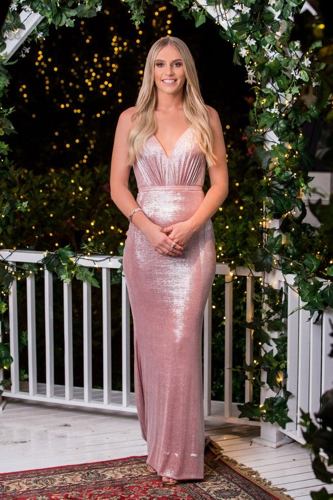 Tara Norman in a pink dress on The Bachelor