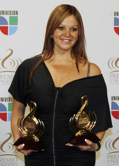 FILE -- In this Thursday March 26, 2009 file photo Mexican singer Jenni Rivera poses backstage during the Premio Lo Nuestro Latin music awards in Coral Gables, Fla. Rivera and Mexican pitcher Esteban Loaiza are being added to the Las Vegas Walk of Stars. They are the second couple to be honored by the Las Vegas Strip organization. (AP Photo/Wilfredo Lee)