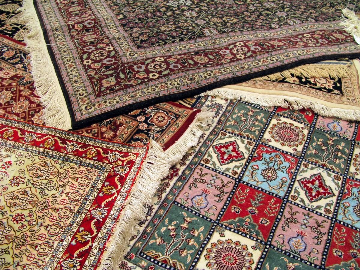 """""""Antique rugs can be expensive,"""" Williams admits. Instead of trying to find a rug that's big enough for your space without blowing your budget, """"use an oversized jute rug for the foundation and layer with a smaller antique rug for pattern."""" Natural materials like jute are fairly affordable and easy to find. Not sure about the layered look? Dip your toes into the water by coordinating your rug colors and materials."""