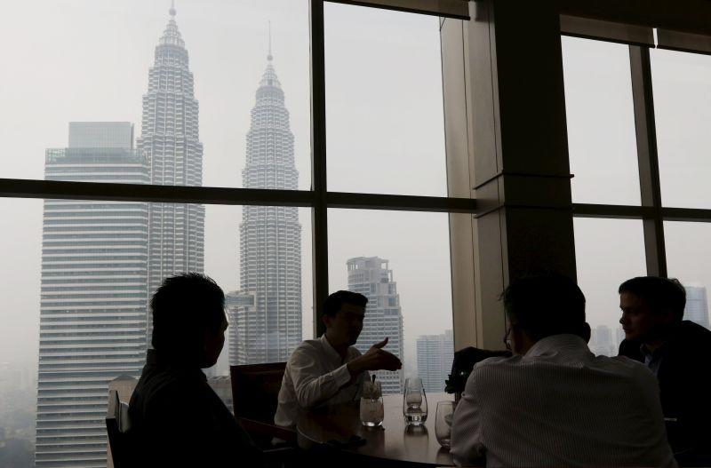 File picture of office workers having lunch in front of the Petronas Towers in Kuala Lumpur. ― Reuters pic