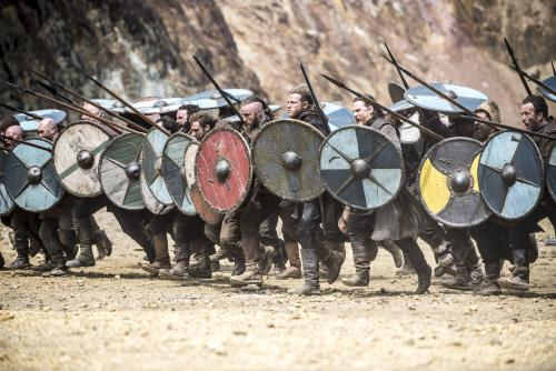 In this photo dated July, 4 2013 is a battle scene from television show Vikings, History's brooding and brutal drama about the 8th-century Nordic warrior Ragnar Lothbrok. After a six-month shoot in Ireland, season two debuts Thursday night sporting a bigger scale, more confident pace and stronger entertainment than last year's uneven, at-times plodding inaugural run.(AP Photo/Bernard Walsh/History)