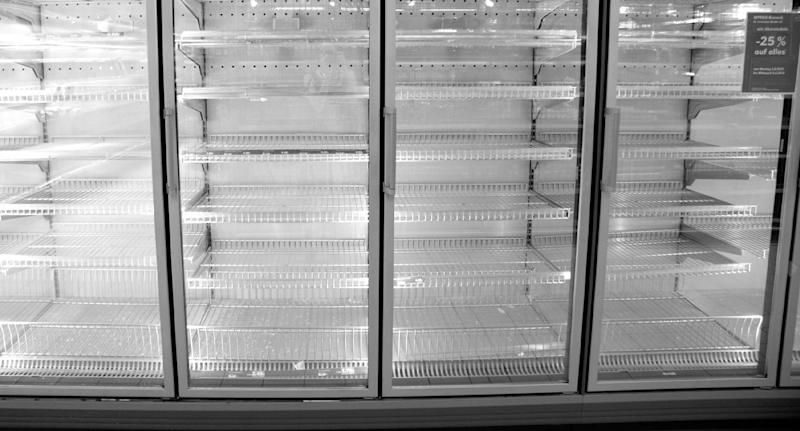 File photo of a commercial fridge after police found a body had been behind one at the back of an abandoned supermarket.
