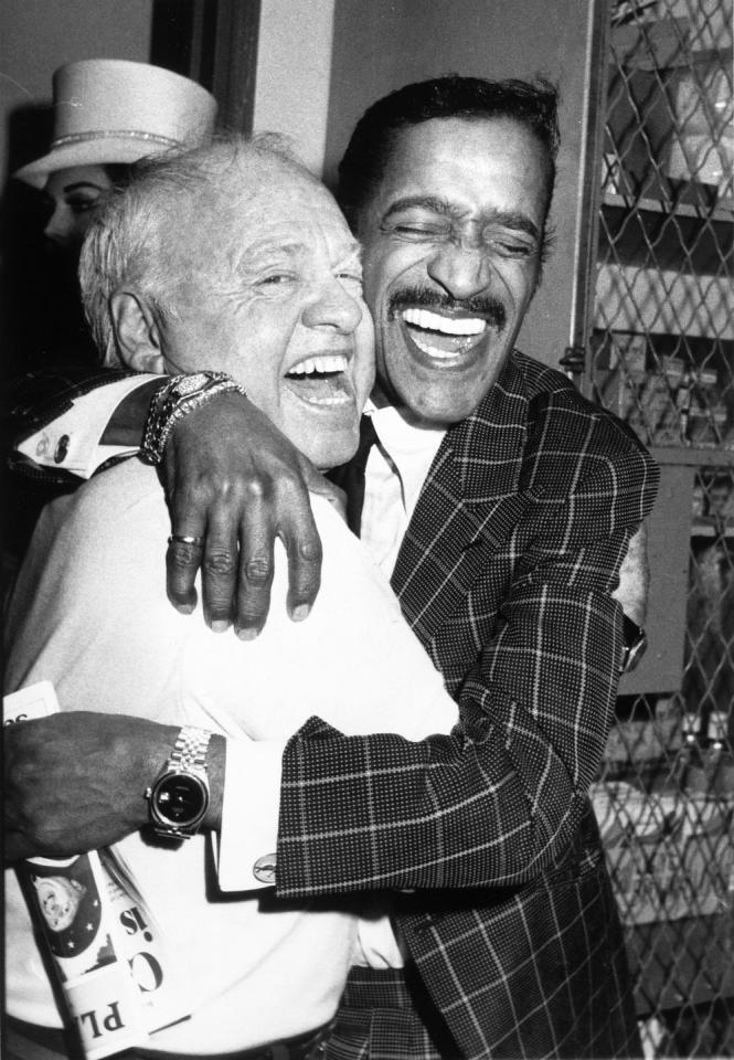 <p>Sammy Davis Jr. congratulates his friend, Mickey Rooney, as he joins him backstage after his Broadway performance in <em>Sugar Babies</em> in 1981. <em></em></p>