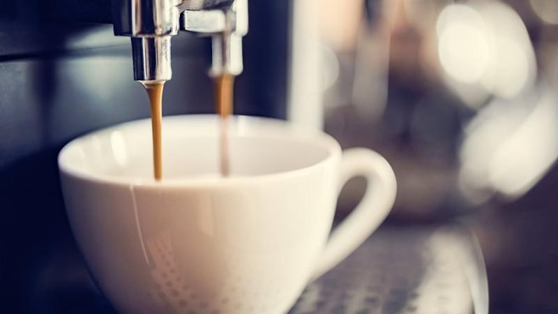 Espresso machine making fresh cup of coffee