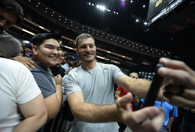 ANAHEIM, CA - AUGUST 14: Former UFC heavyweight champion Stipe Miocic takes a selfie with a fan after holding an open workout for fans and media at Honda Center on August 14, 2019 in Anaheim, California. (Photo by Kevork Djansezian/Zuffa LLC/Zuffa LLC)