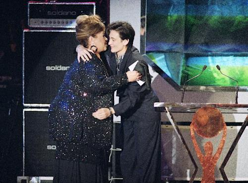 FILE - In this Jan. 13, 1993, photo, singer Etta James, left, gets a hug from fellow singer K d Lang as she is inducted to the Rock and Roll hall fame, in Los Angeles. The singer's manager says Etta James has died in Southern California. Lupe De Leon tells The Associated Press the singer died early Friday, Jan. 20, 2012 at Riverside Community Hospital. De Leon says the cause of death is complications of leukemia. (AP Photo/Kevork Djansezian)