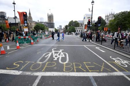 """A writing on the roadside that reads """"Stop Brexit"""" is seen near the Houses of Parliament in London"""