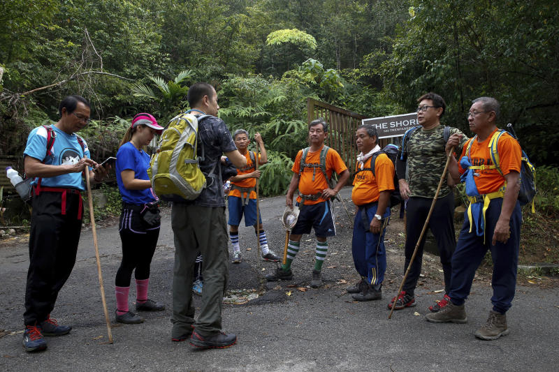 Volunteers receive a briefing before conducting a search and rescue operation for a missing British girl at a forest in Seremban, Malaysia, Sunday, Aug. 11, 2019. The parents of 15-year-old London girl Nora Anne Quoirin who mysteriously disappeared from a Malaysian resort a week ago said Saturday that she wasn't independent and had difficulty walking, in new details to support their conviction that she was abducted. (AP Photo/FL Wong)